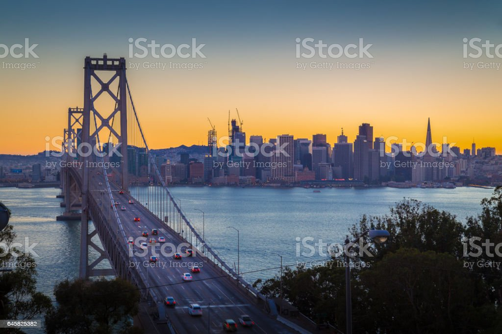 San Francisco skyline with Oakland Bay Bridge in twilight, California, USA stock photo