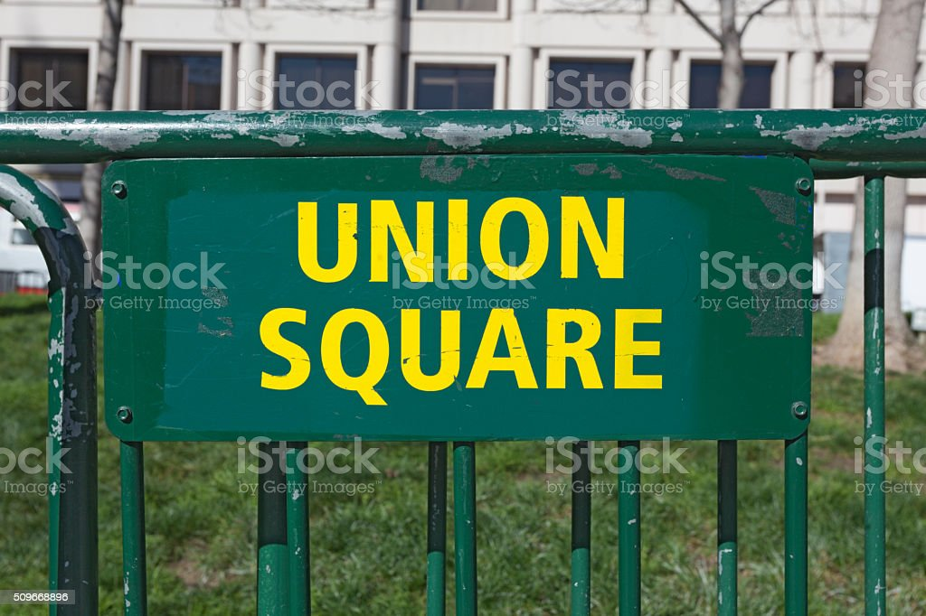 San Francisco Union Square Green and Yellow Barricade stock photo