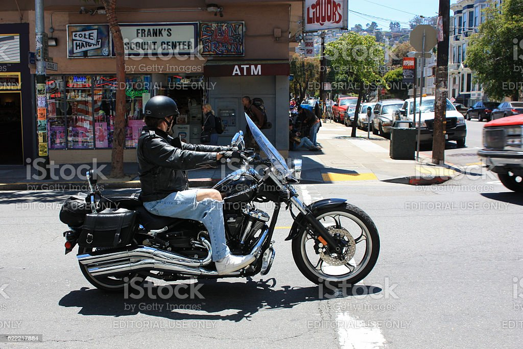 San Francisco, USA - 11 June 2010. Biker rides through stock photo