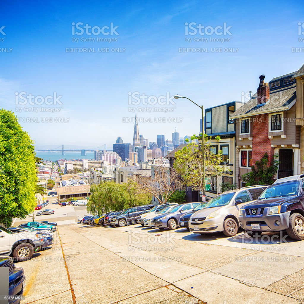 San Francisco USA parked cars on steep hill with skyline stock photo