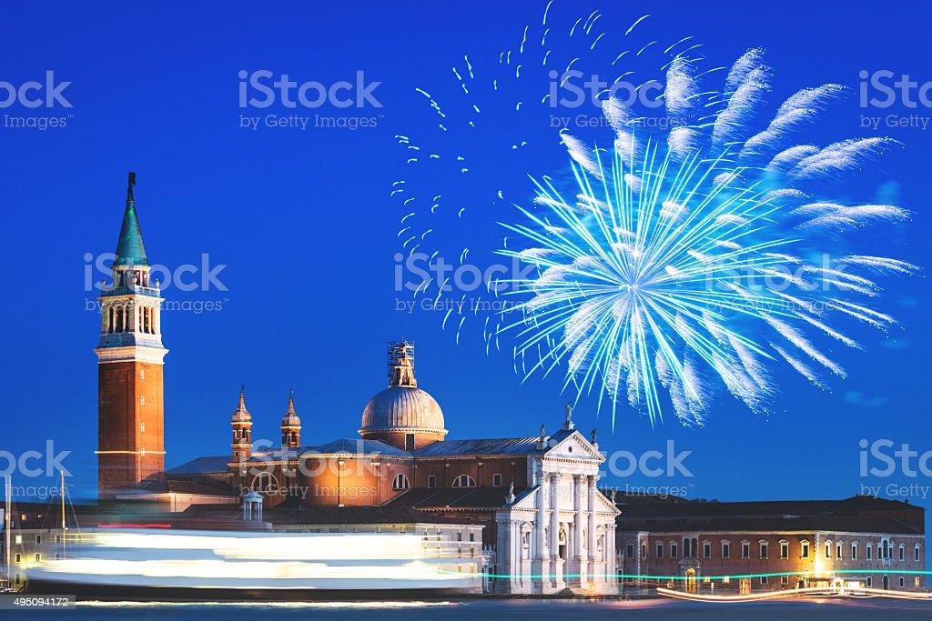 San giorgio island on venice lagoon with fireworks stock photo