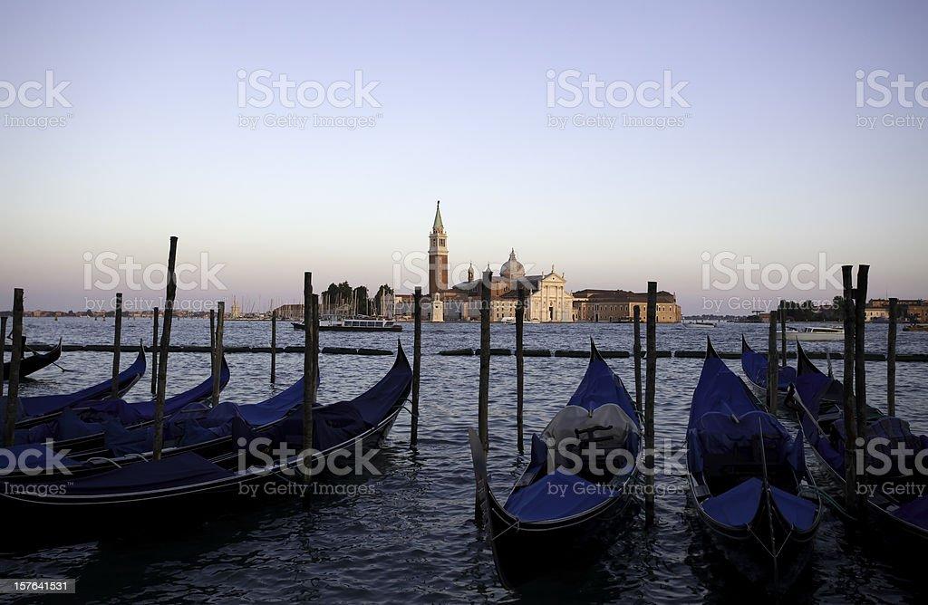 San Giorgio Maggiore church and gondolas in Venice by sunset royalty-free stock photo