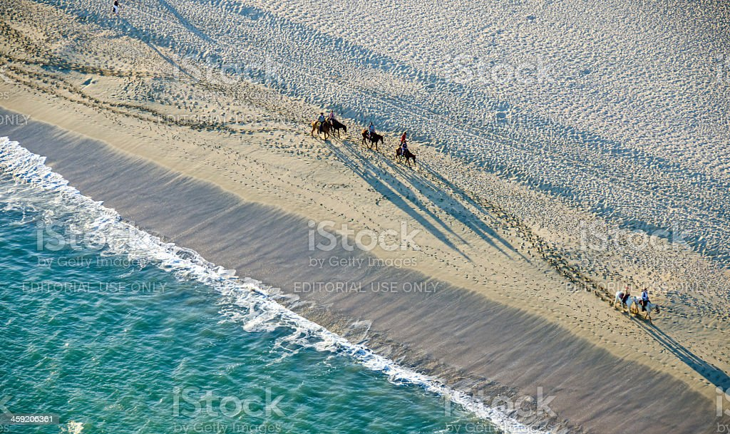San Jose Del Cabo beach horse back riders- from above stock photo