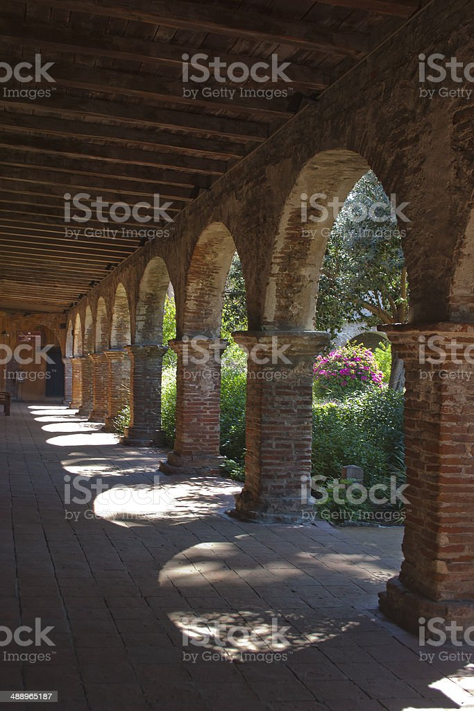 San Juan Capistrano missions archways with garden stock photo
