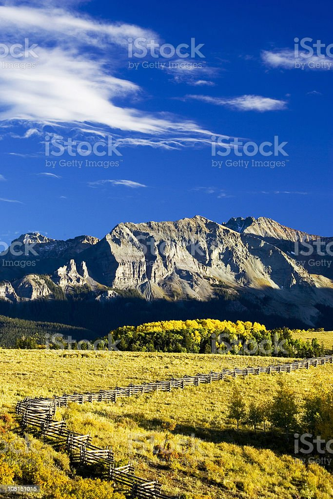 San Juan Mountains with Aspen Forest and Fields stock photo