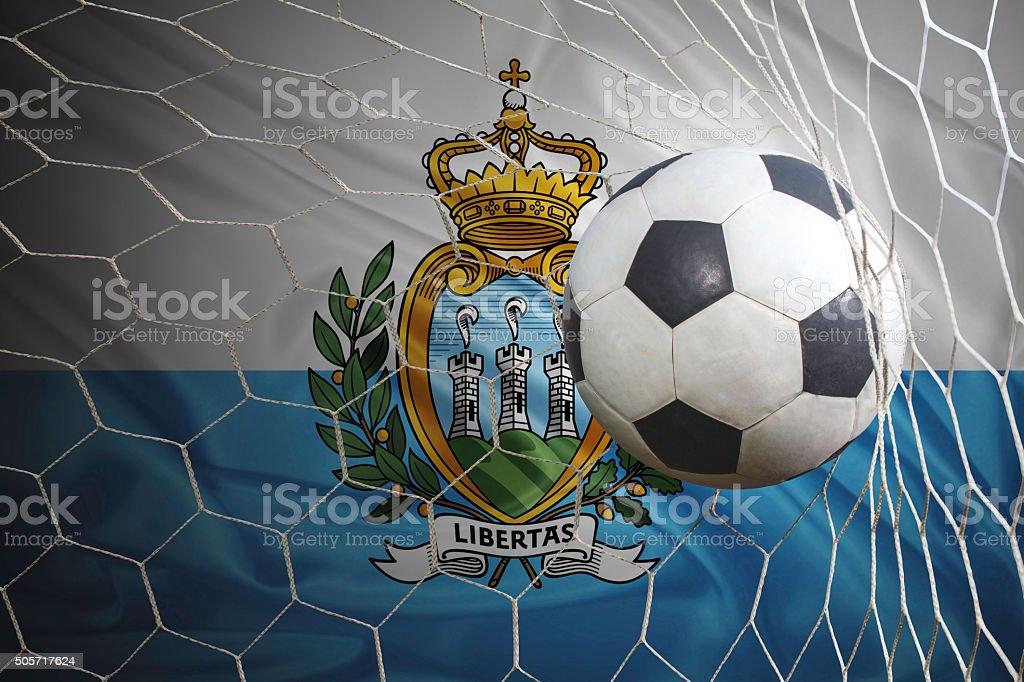 San Marino flag and soccer ball, football in goal net stock photo