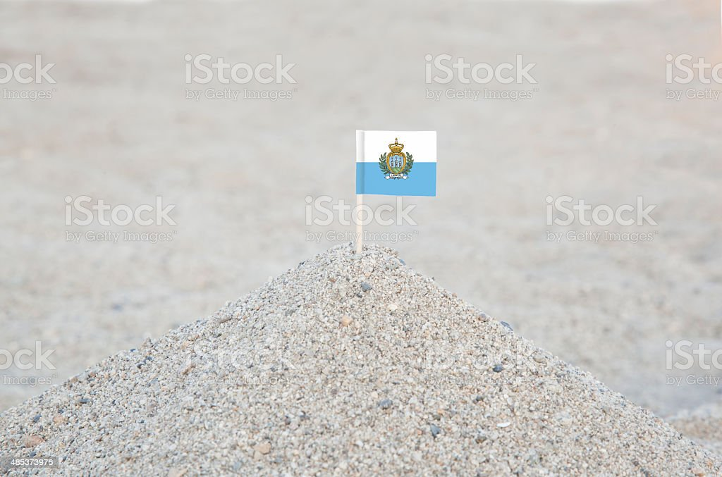 San Marino Flag on the Beach stock photo