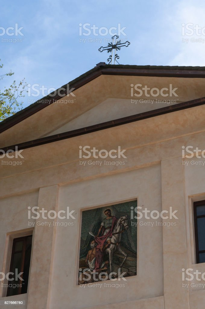 San Martino: details of the parish church of San Martino, Saint Martin, the village starting point for the hiking in the Val di Mello (Mello Valley) stock photo