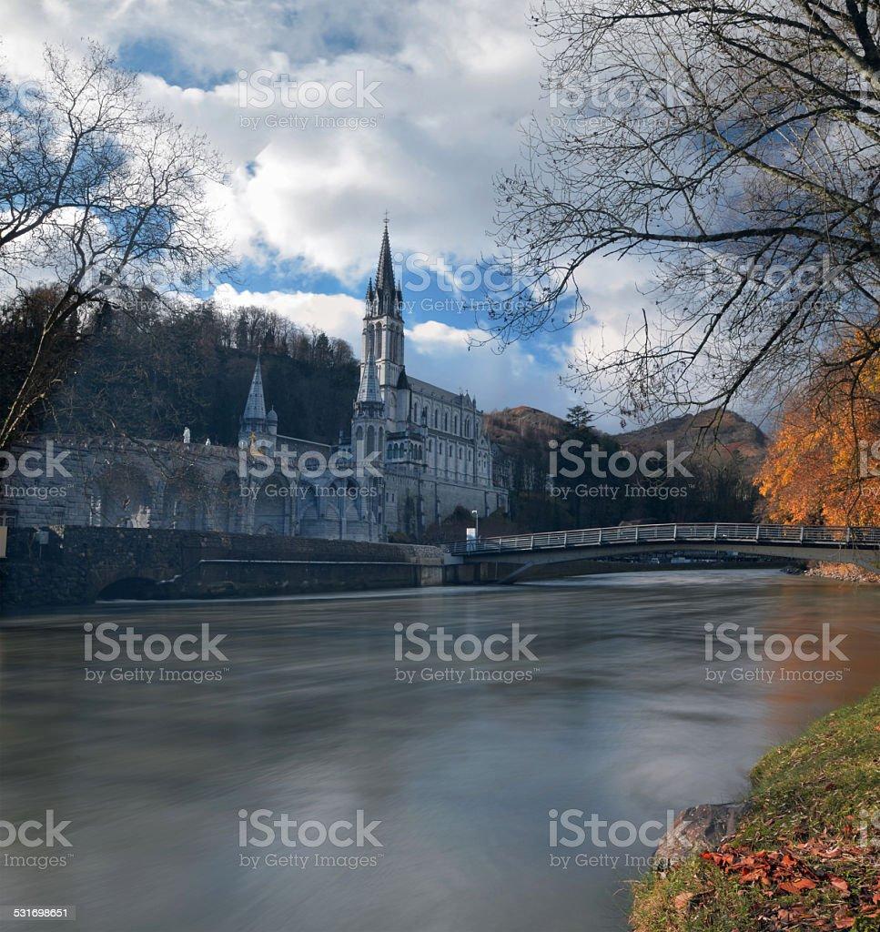 Sanctuaries of Lourdes from the border of Gave de Pau River stock photo