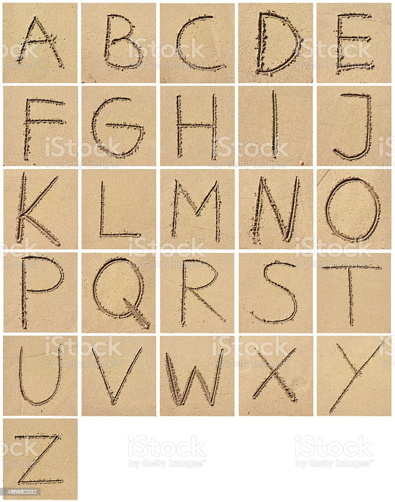 Sand alphabet stock photo