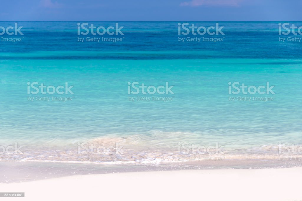 Sand and caribbean sea background stock photo