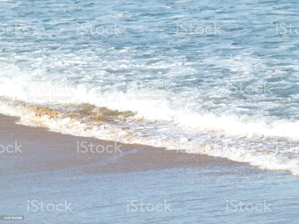 Sand and water stock photo