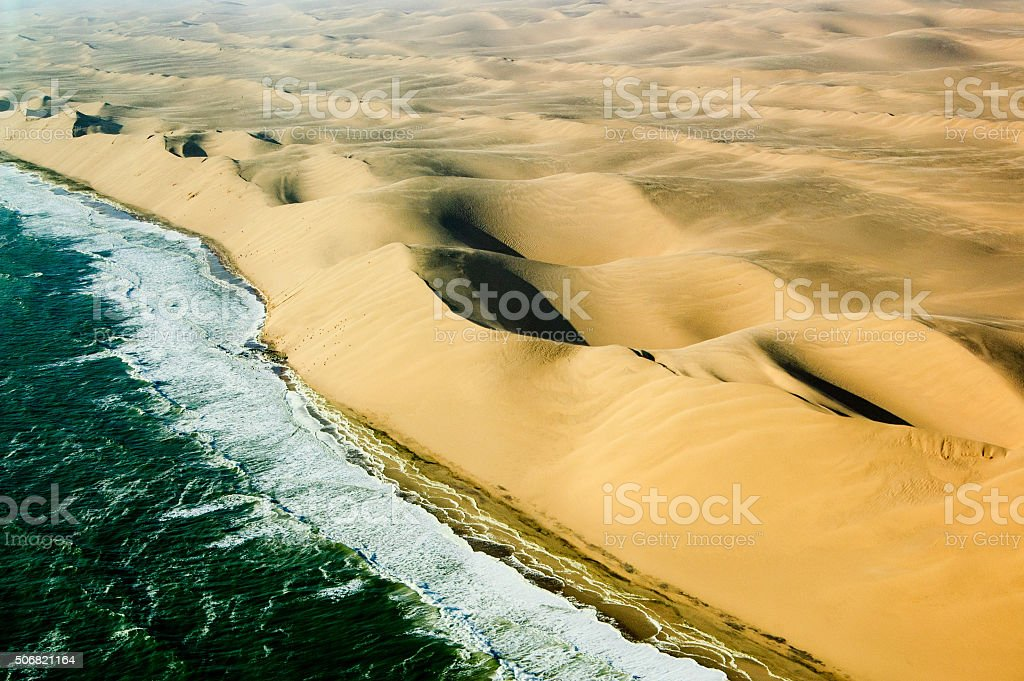 Sand and Water Waves 3 stock photo