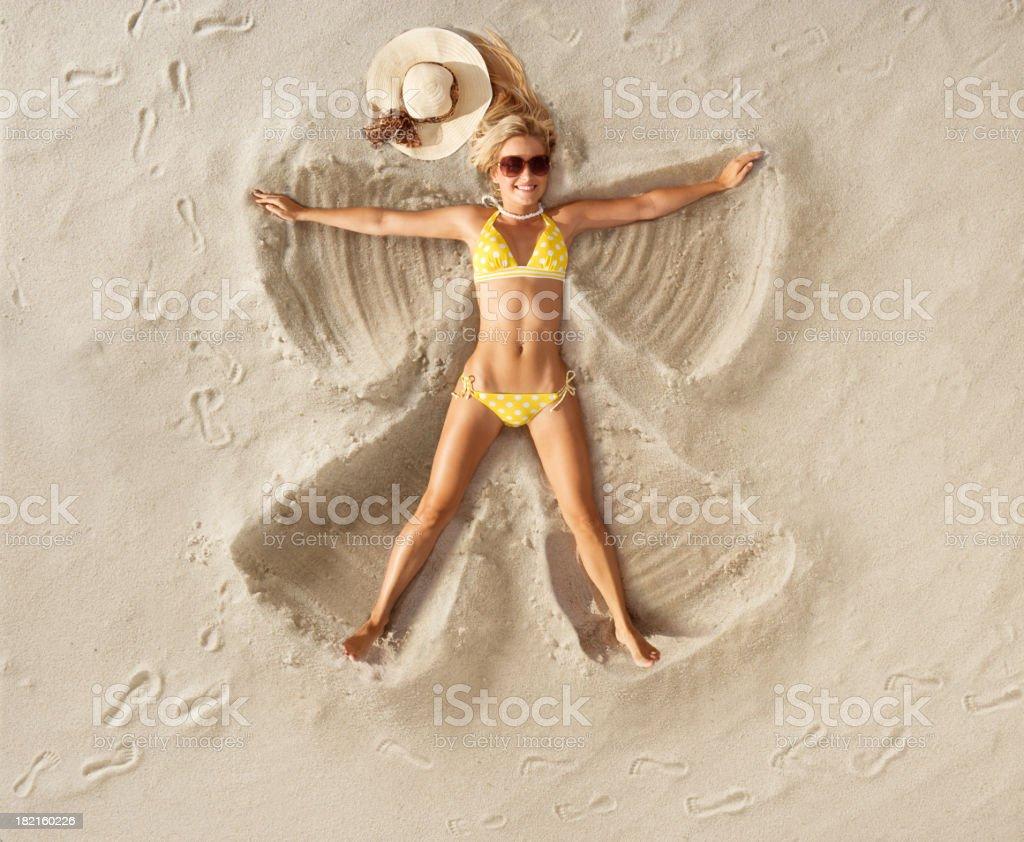 Sand Angel in Polka dot bikini stock photo