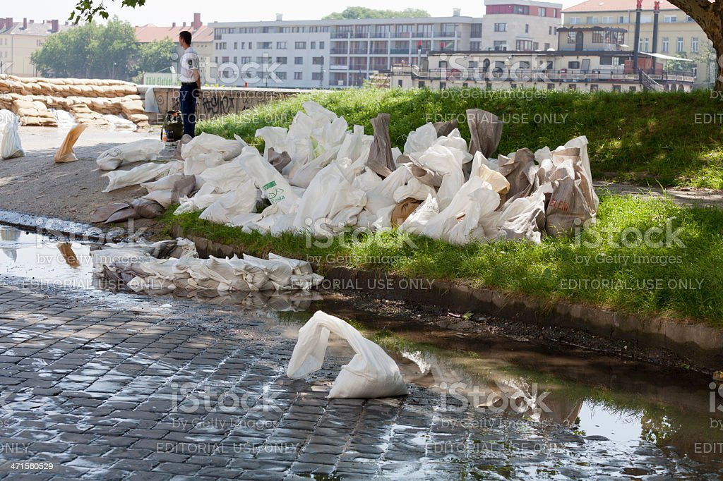 Sand bags on the shore of Danube royalty-free stock photo