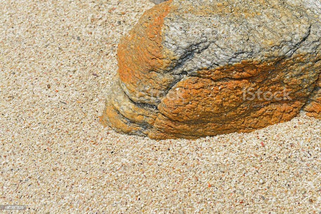 Sand beach rocks texture stock photo