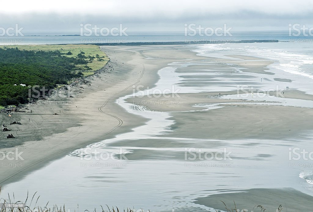 Sand beach where ocean meets river in Washington state royalty-free stock photo