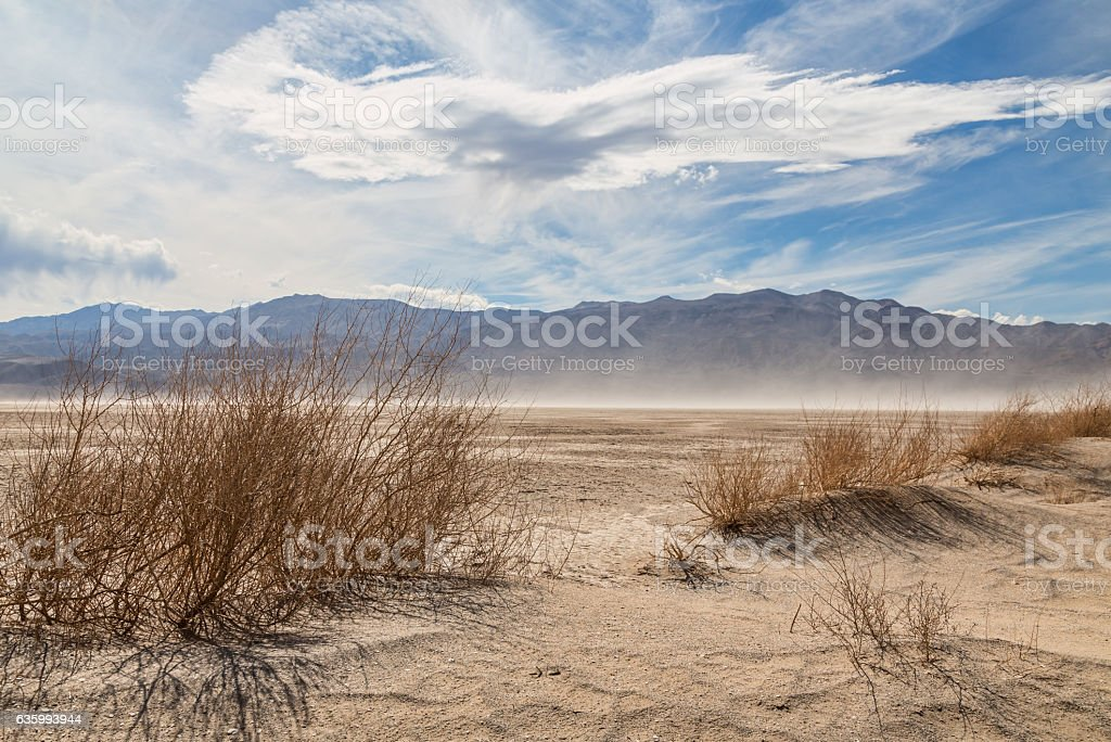 Sand blowing across the desert in Death Valley stock photo