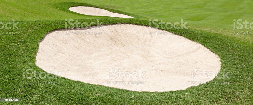 Sand bunker on the beautiful golf course stock photo