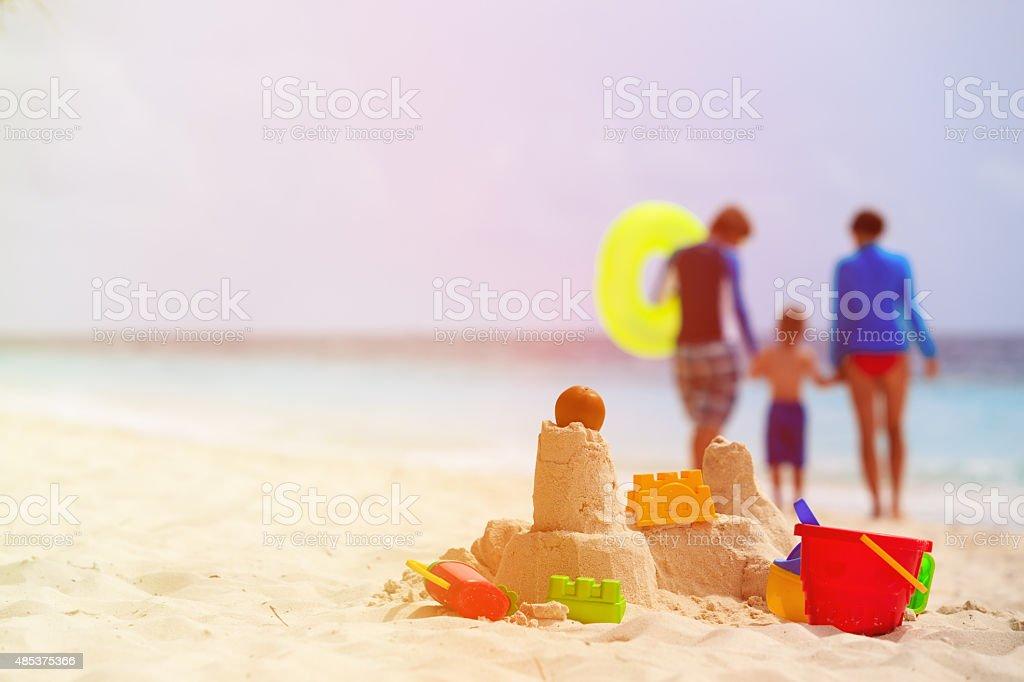 sand castle and toys on tropical beach stock photo