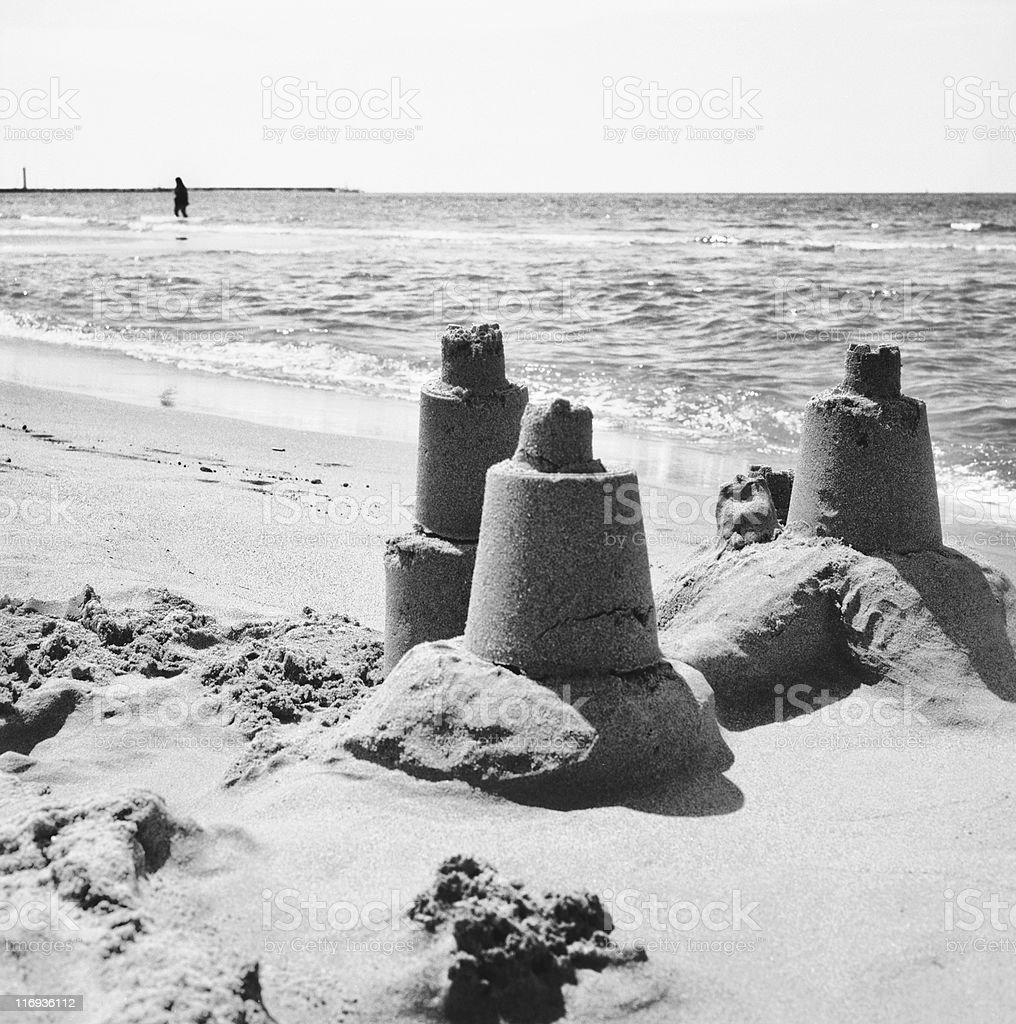 Sand castle at the beach on a sunny day stock photo