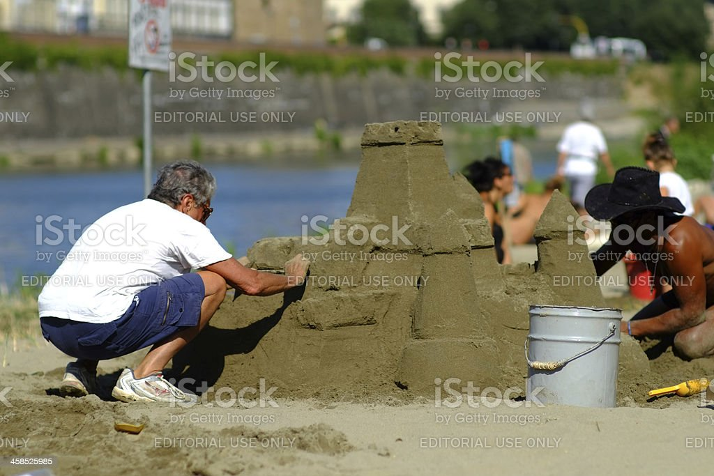 Sand castle near the river stock photo