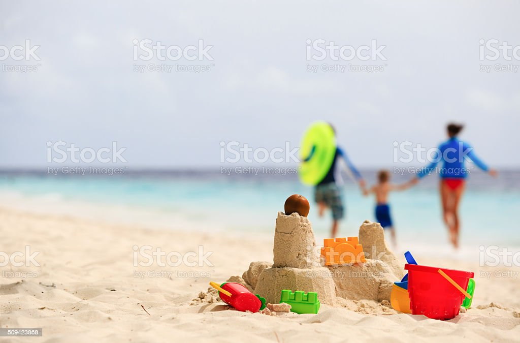 sand castle on tropical beach, family vacation stock photo