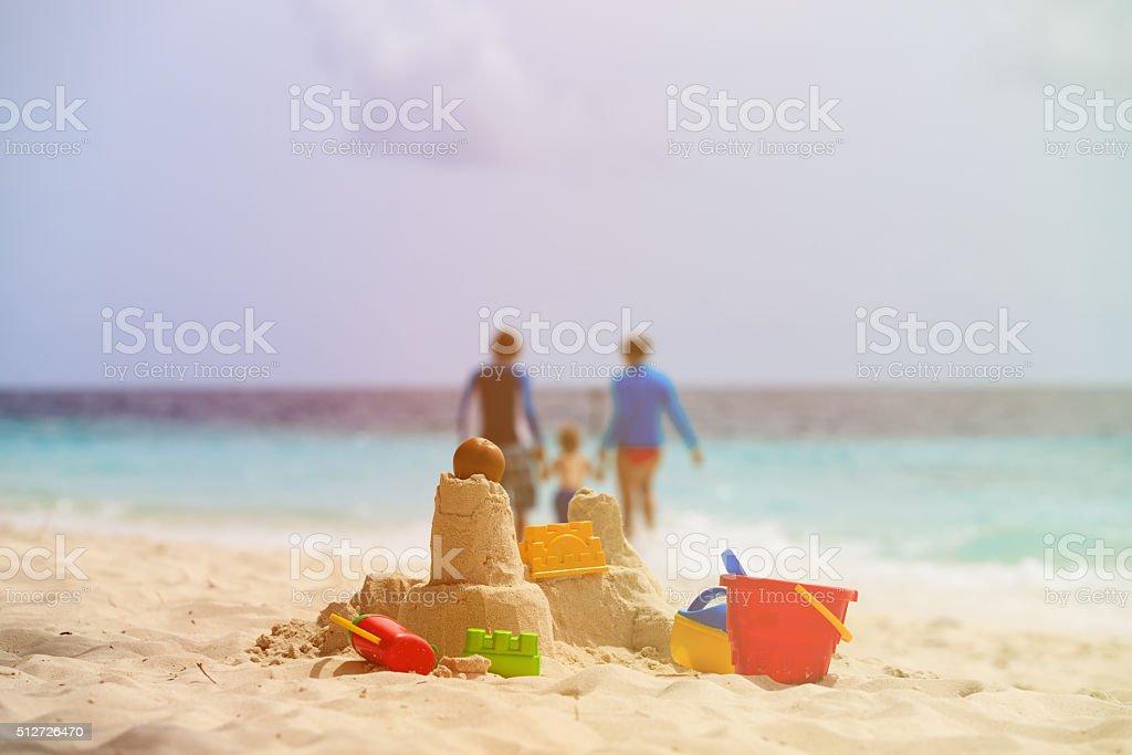 sand castle on tropical beach, family vacation stock photo