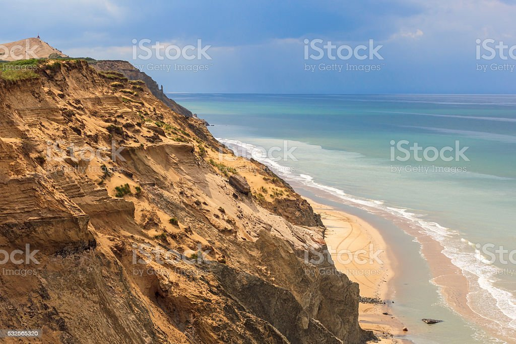 Sand cliffs and beach by the sea stock photo