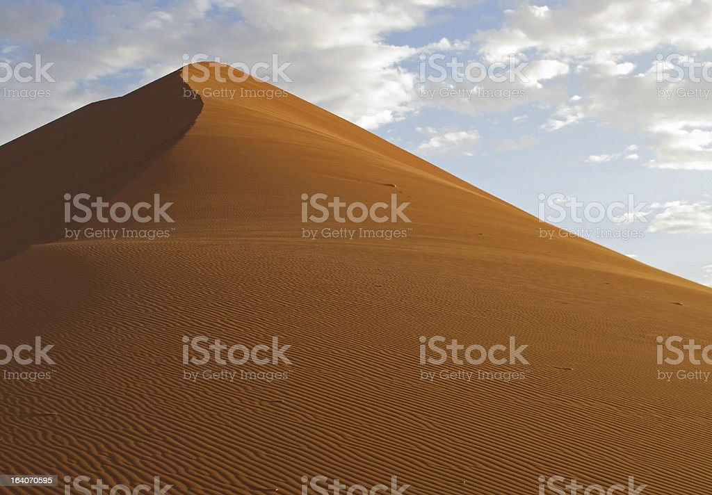 Sand dune against the sky royalty-free stock photo
