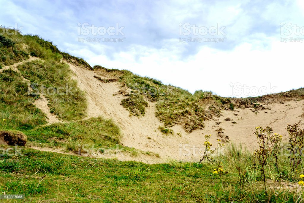 Sand dune and beach erosion by tides stock photo