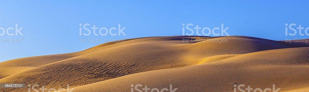sand dune in sunrise royalty-free stock photo
