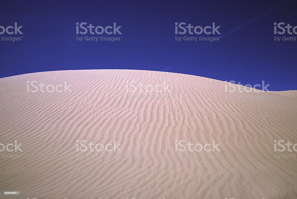 Sand Dune, Ripples and Blue Sky stock photo