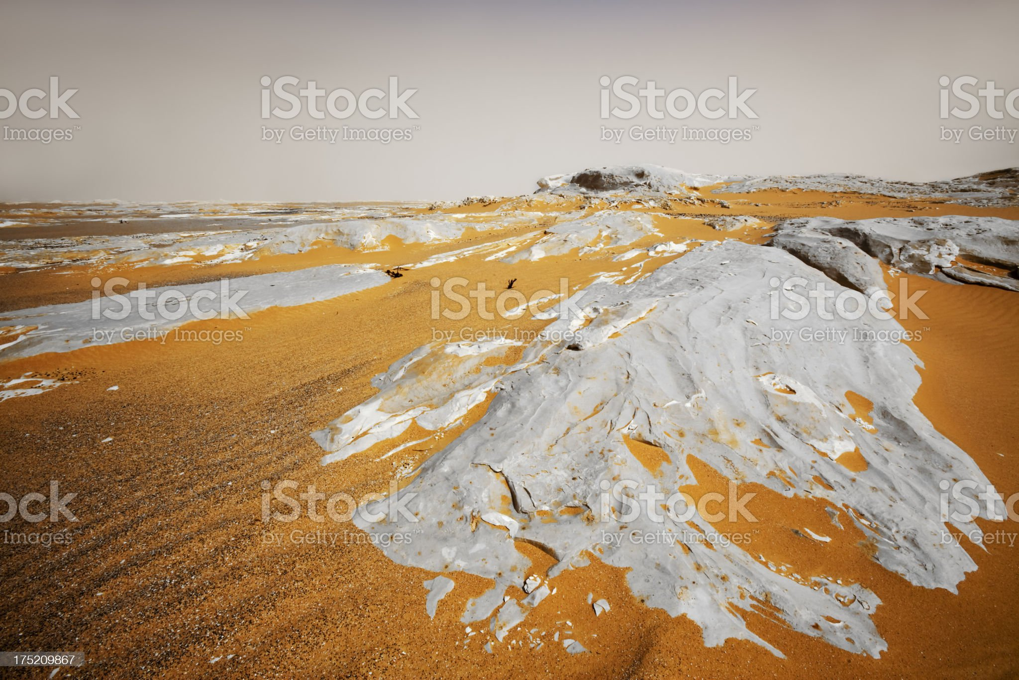 Sand dunes and rocks royalty-free stock photo
