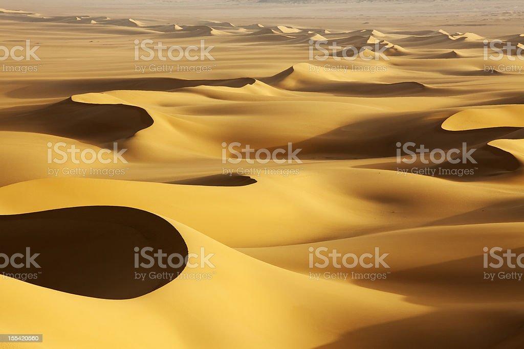 Sand dunes at sunrise stock photo