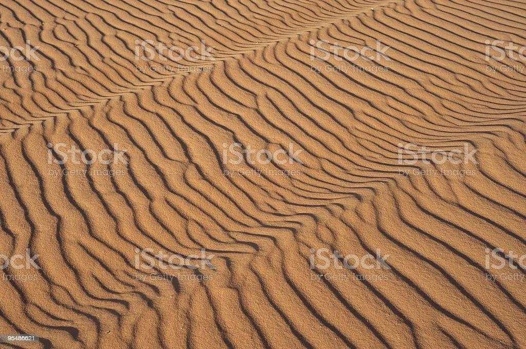 Dunas de areia ao pôr-do-sol foto royalty-free