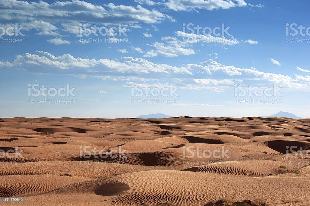sand dunes desert landscape stock photo