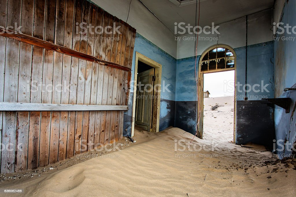 Sand dunes in abandoned house stock photo