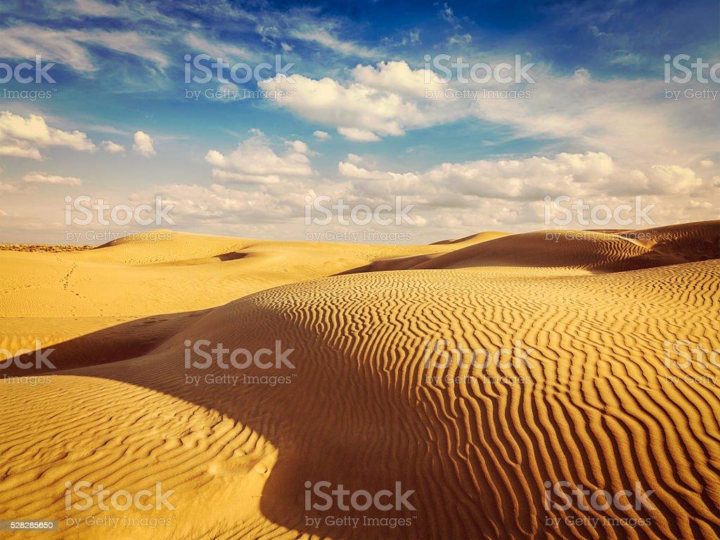 Sand dunes in desert stock photo