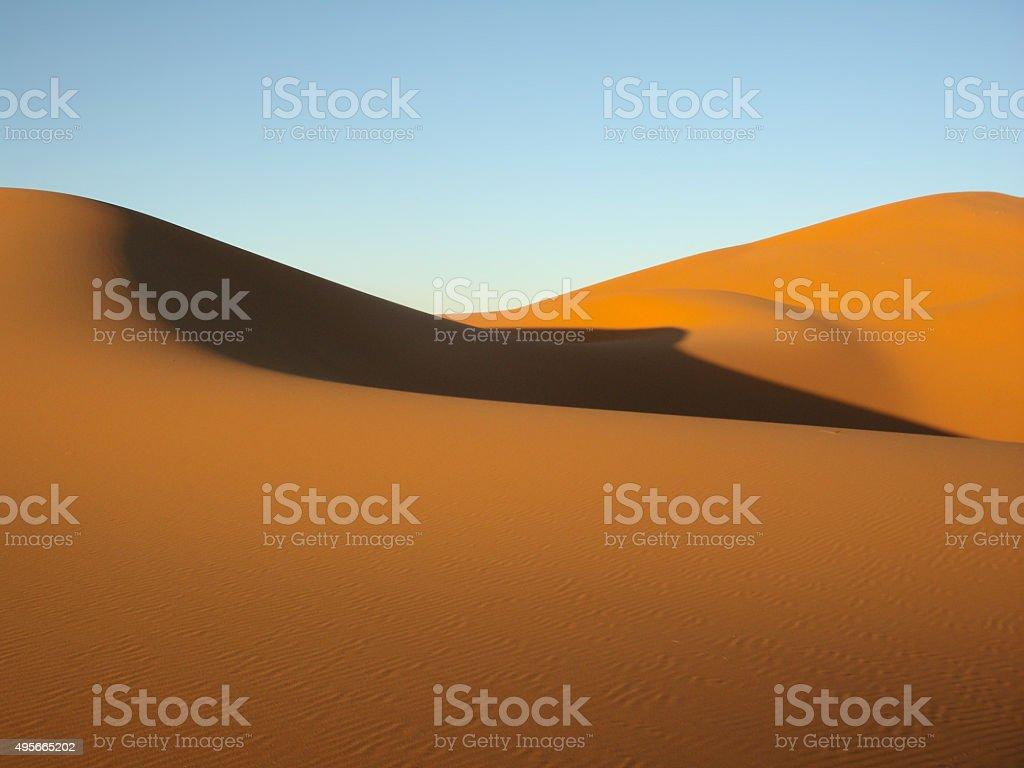 Sand dunes in the desert stock photo