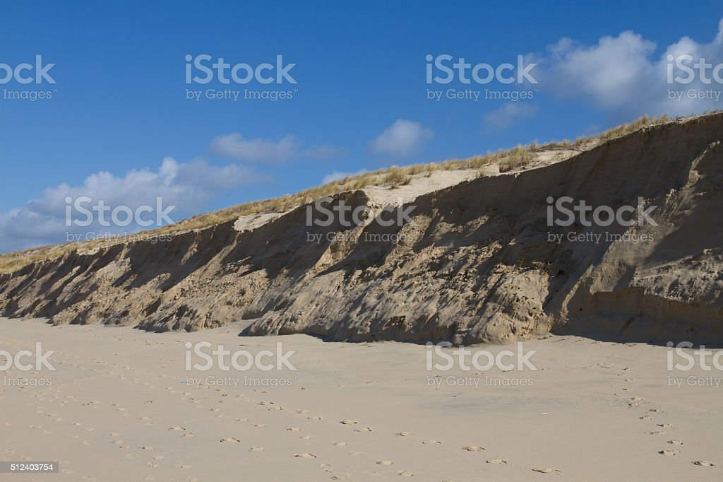 Sand Dunes on Windy Day with blue sky stock photo