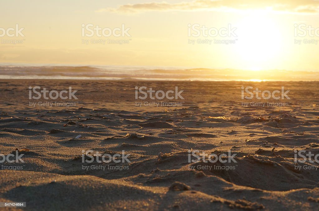 Sand During a Beachside Sunset stock photo