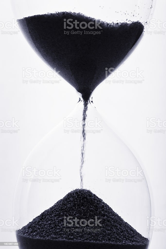 Sand falling through hourglass royalty-free stock photo