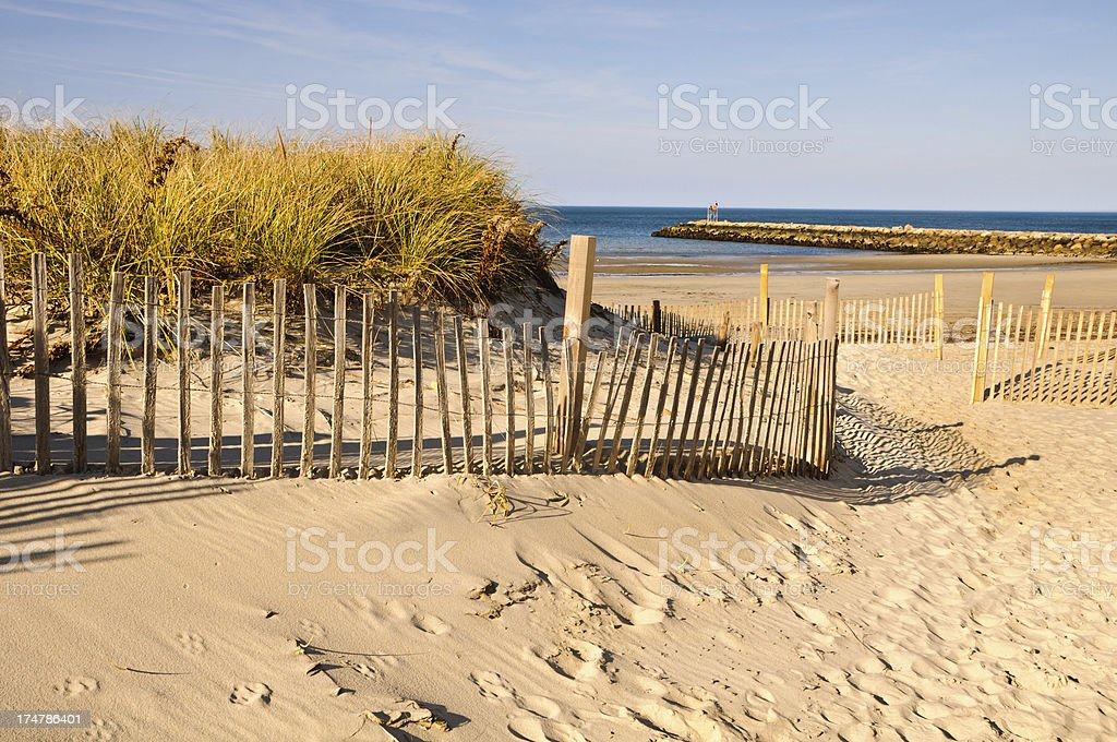 Sand Fence and Jetty stock photo