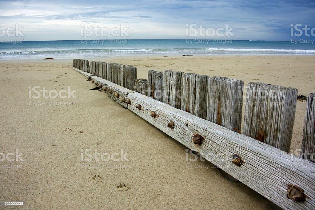 Sand fence at Torquay stock photo