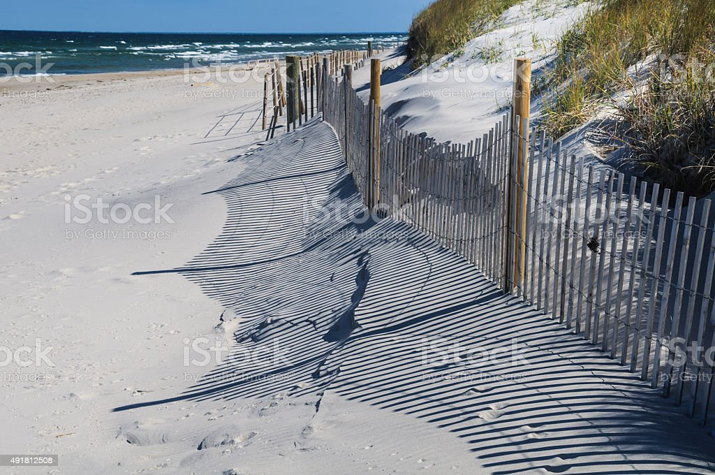 Sand Fence Shadows stock photo