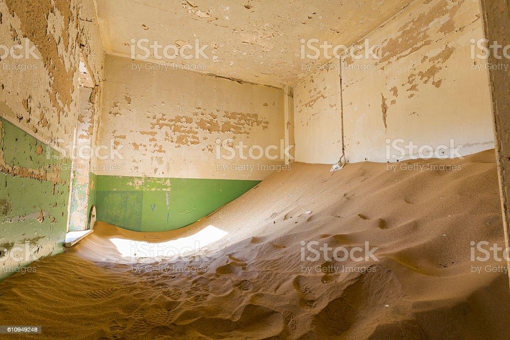 Sand filled room at Kolmanskop stock photo