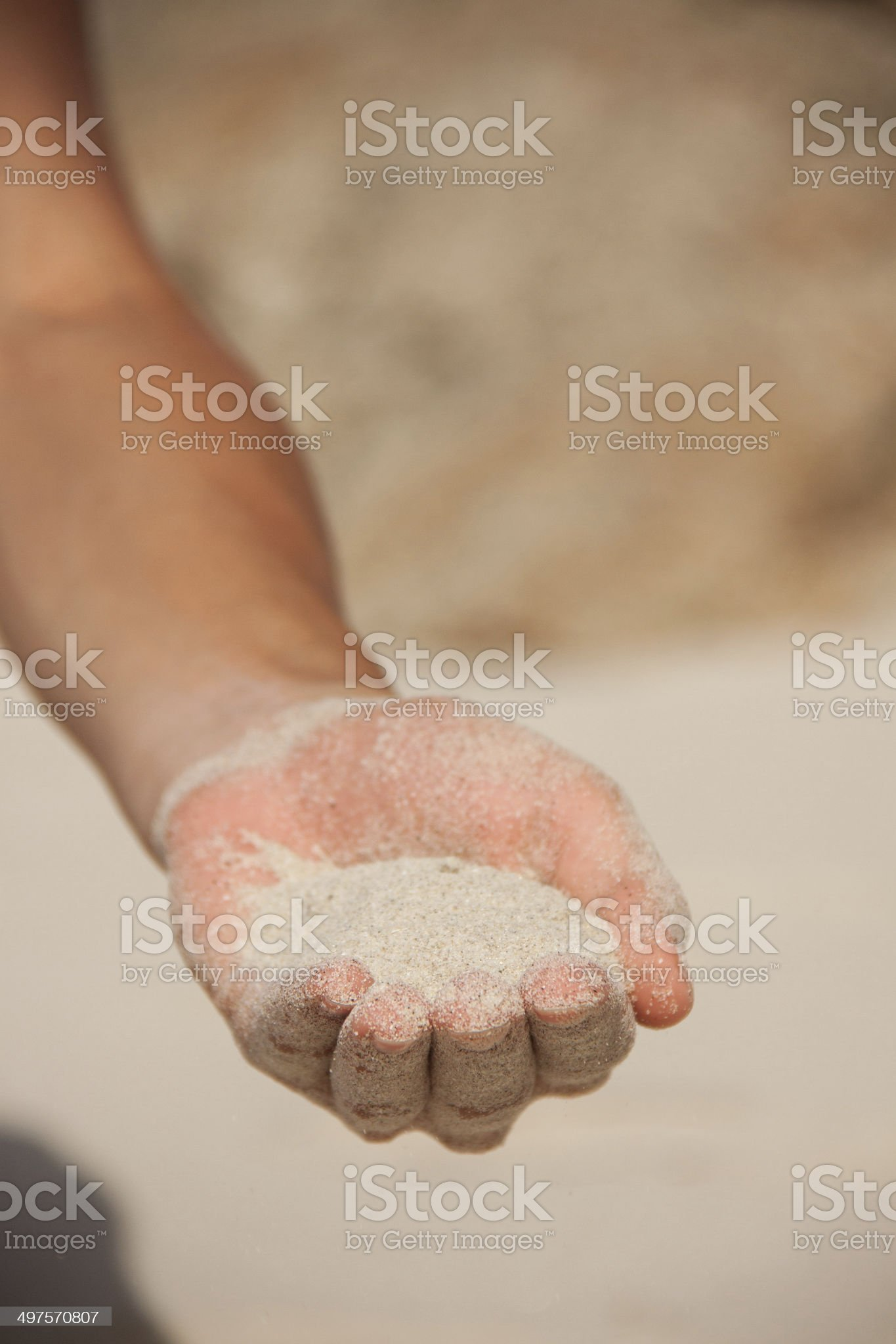 sand flows through the female hands royalty-free stock photo