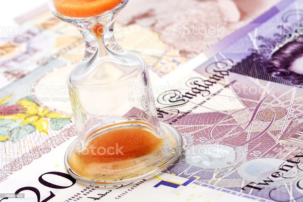 Sand glass on England pounds royalty-free stock photo
