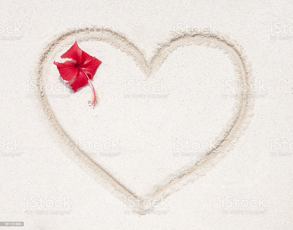 Sand Heart with Hibiscus Flower royalty-free stock photo